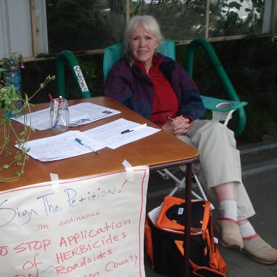 Ellen at the PT Food Co-op gathering names on the petition